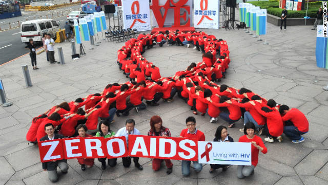 Volunteers in Taiwan join a human chain in the form of a red ribbon for HIV/AIDS for World Aids Day 2011.