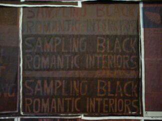 "Text reads: ""sampling black romantic interiors"""